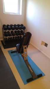 home gym bench and dumbbells