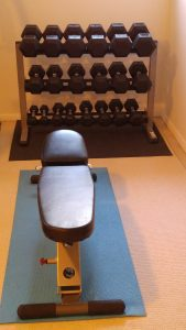 set of dumbbells and bench home gym